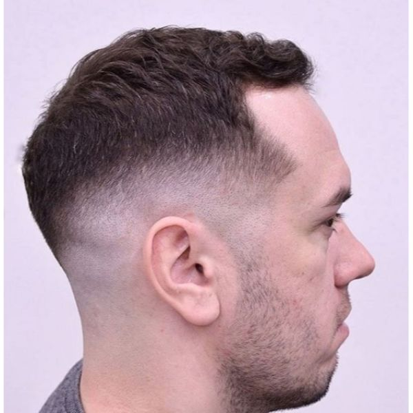 Sharp Fade with Curly Top Low Maintenance Haircuts For Men
