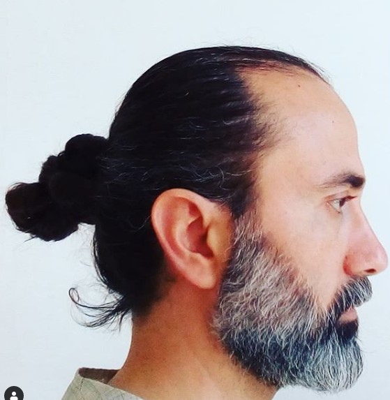 Braided Man Bun Hairstyle with Grey Strands