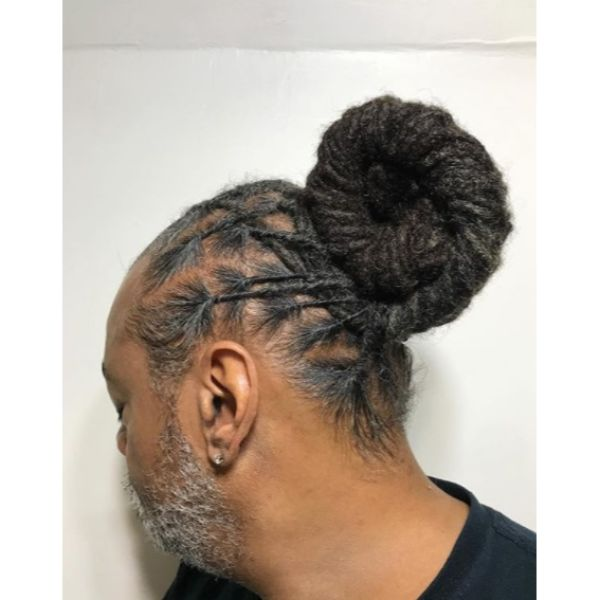 Coiled Bun with Thin Dreadlocks Styles For Men