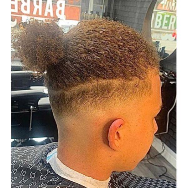 Curly Brown Man Bun with High Fade Man Bun Hairstyles