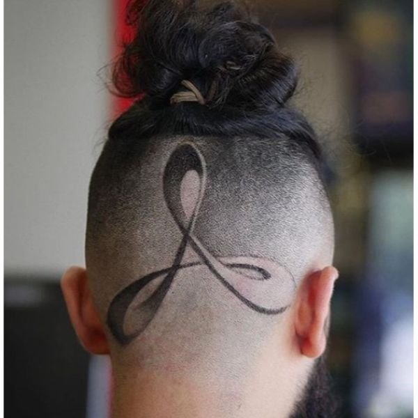 High Fade with Man Bun and Intricate Side Design Man Bun Hairstyles