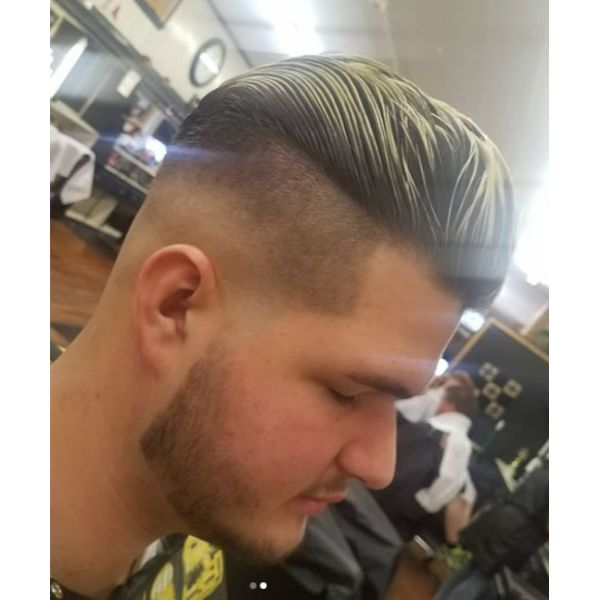 High Fade with Slicked Back Hairstyle