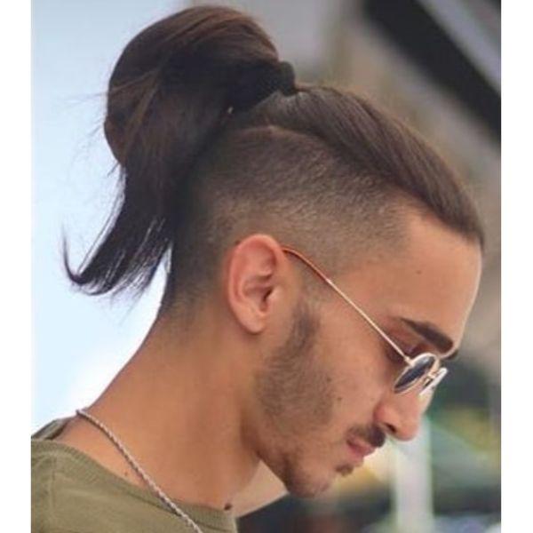 High Fade with Undone Messy Bun Man Bun Hairstyles