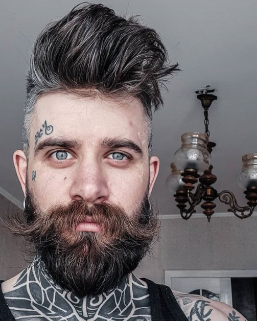 High Fade with Up-swept Hairstyle and Hipster Beard