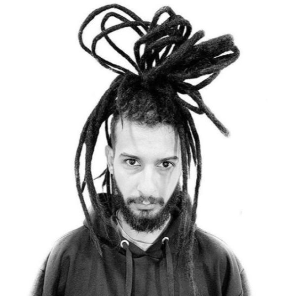 Intricate Top Knot with Messy Dreadlocks Styles For Men