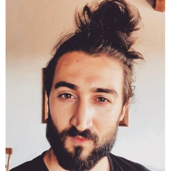 Messy High Bun Hairstyle