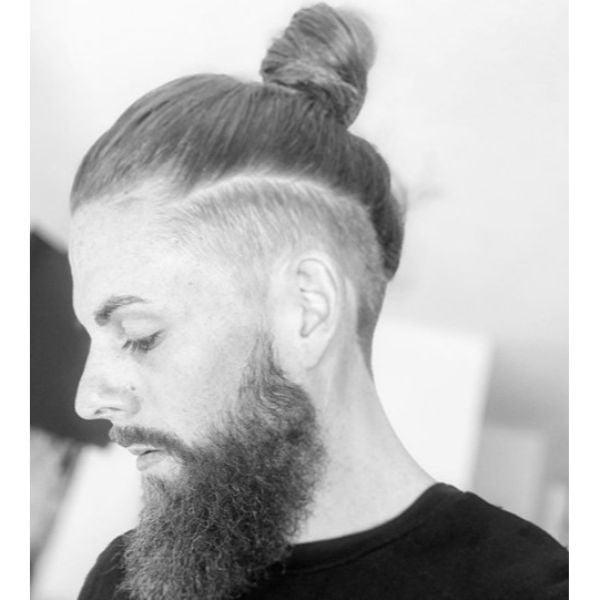 Mid Fade with Sleek High Bun Hairstyle Man Bun Hairstyles