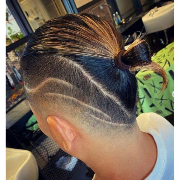 Mohawk Man Bun Fade with Side Razor Design