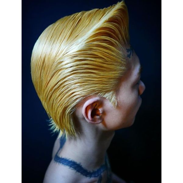 Shiny Blonde Pompadour Hairstyle With Wet Look
