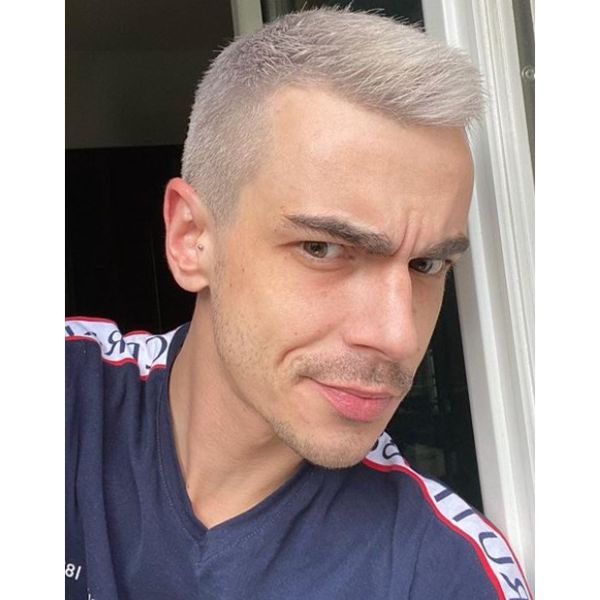 Short Gray Hairstyle with Spiky Texture silver grey hair men