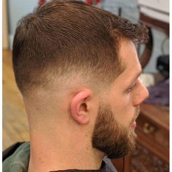 Short Trimmed Haircut with Red Strands