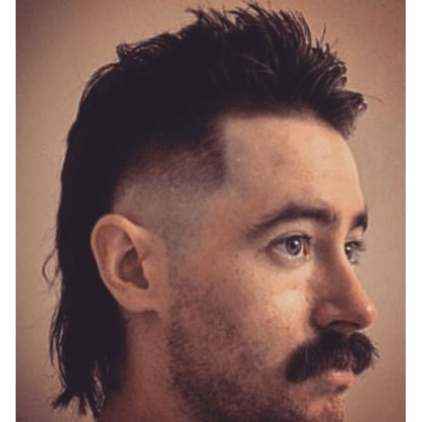 Skin Fade with Modern Mullet Hairstyle For Men with Straight Hair