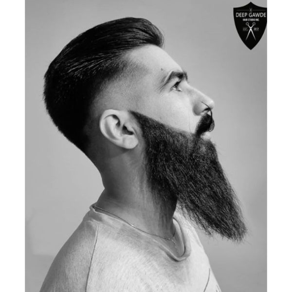 Slicked Back Low Fade with Long Beard