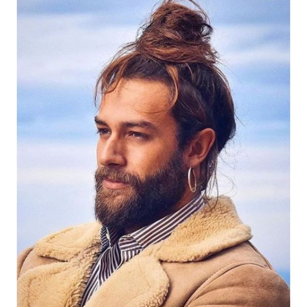 Top Bun with Falling Strands Hairstyle