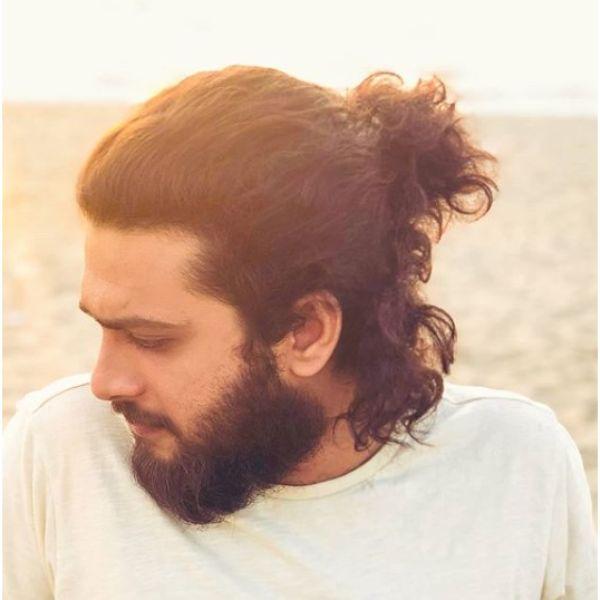 Undone Man Bun with Free Falling Strands