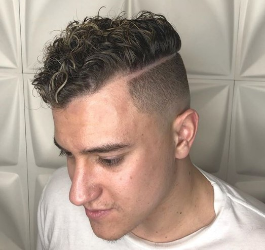 Bald Fade with a Hard Part and Blonde Highlights