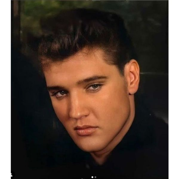 Elvis Presley Tousled Look With Messy Top 1950s mens hairstyles