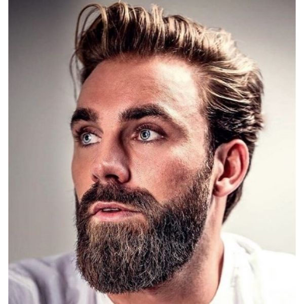 Flow Haircut with Side-Swept Hairstyle and Trimmed Beard