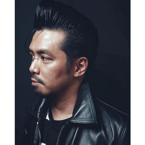 High Pompadour with Falling Strands Haircut