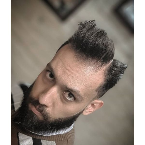 High Swept Hairstyle with Side Part and Skin Fade