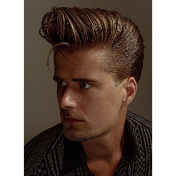 High Swept Pompadour With Falling Strands