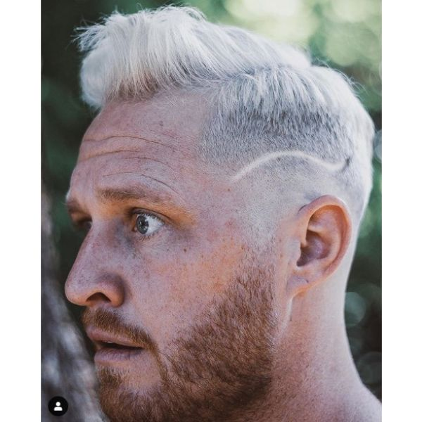 Ice Blonde Skin Fade with Side Razor Design