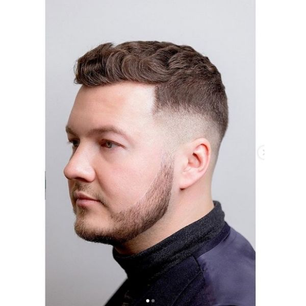 Low Fade Man Hairstyle With Wavy Top