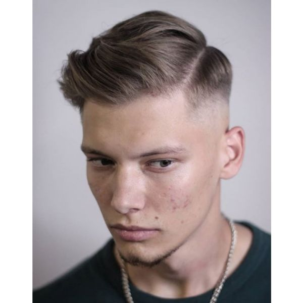 Low Fade with Wavy Top and Side Part