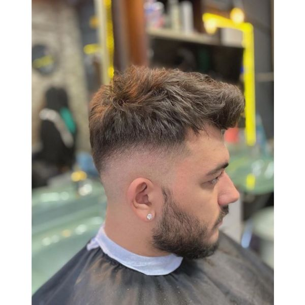 Mid Fade with Textured Top Hairstyle