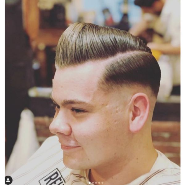 Shiny Pompadour Hairstyle with Low Fade