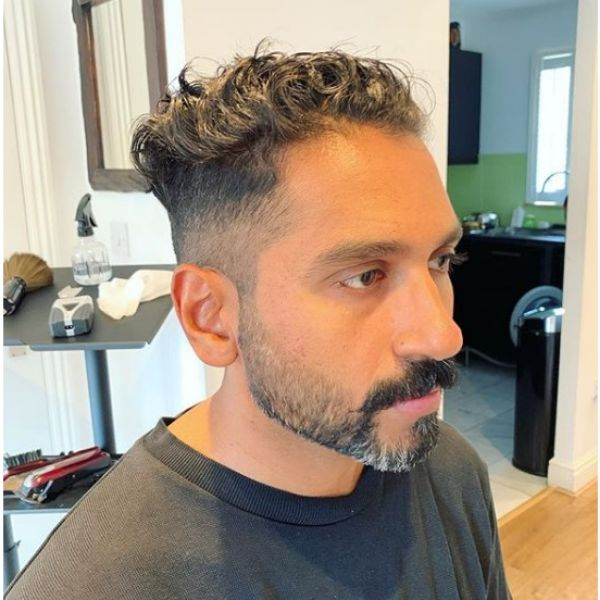 Skin Fade with Curly Top Hairstyle