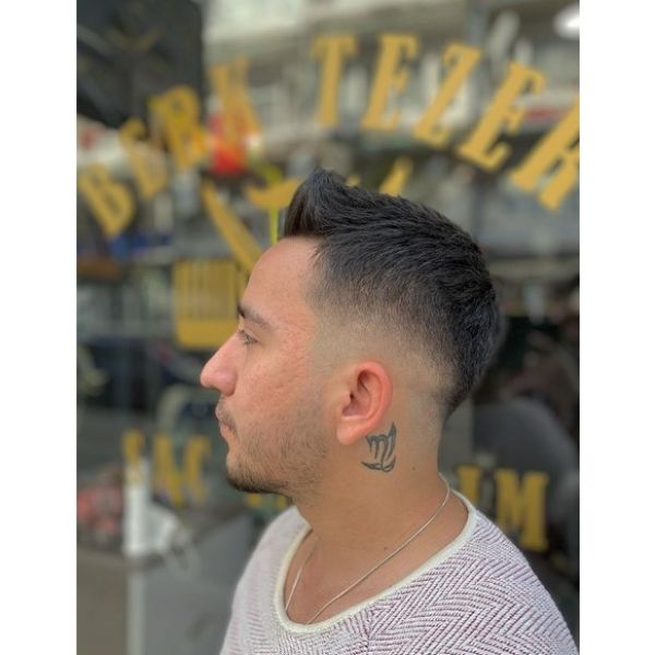 Skin Fade with Up-swept Top Hairstyle