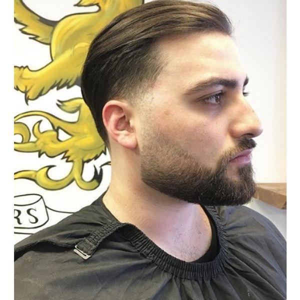 Sleek Swept-back Hairstyle with Razor Fade
