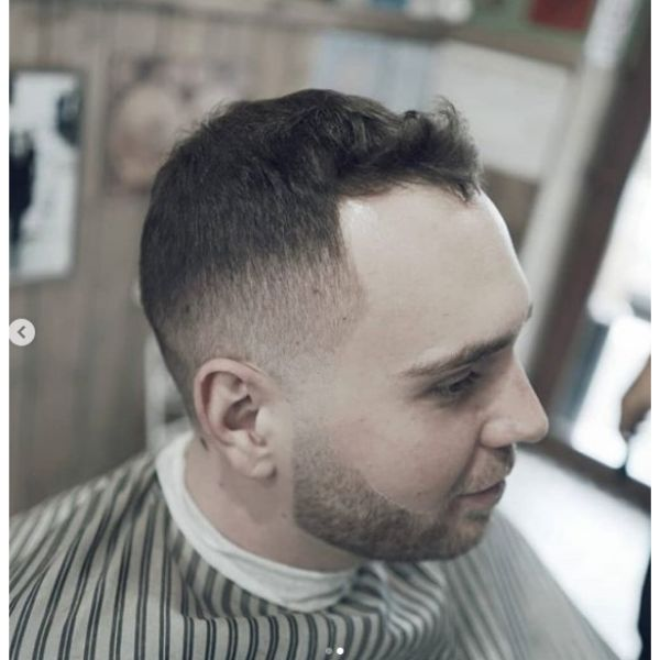 Subtle Fade with Wavy Top Hairstyle