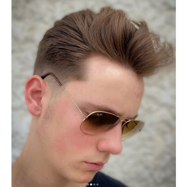 Undone Pomp Hairstyle with Skin Fade Hairstyles For Men With Receding Hairlines