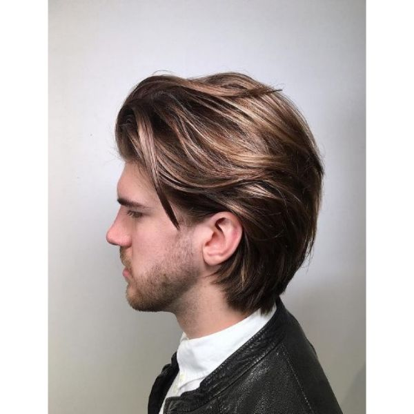 Mid Length Beige Haircut With Falling Strands