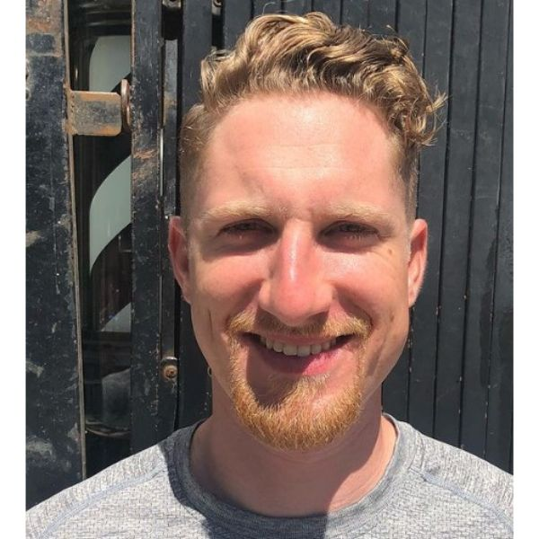 Blonde Curly Top With Faded Sides and Beard