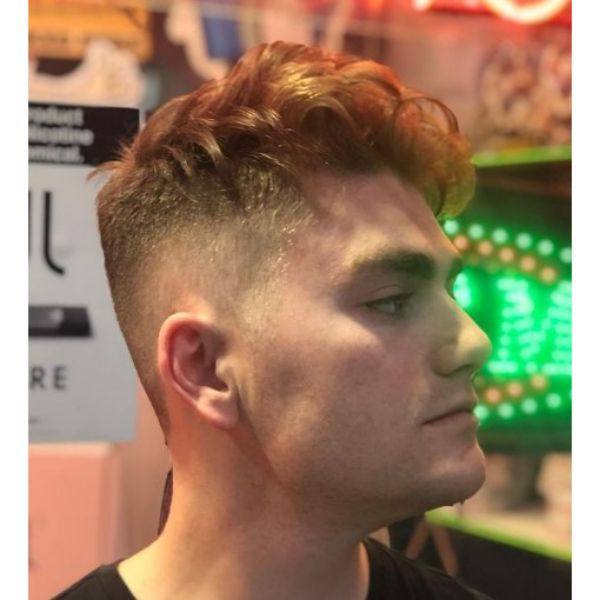 Blonde High Fade With Curly Top Hairstyle For Men