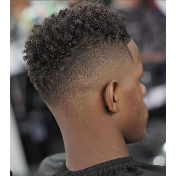 Blurry Fade With Coily Curls Hairstyle For Men