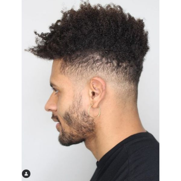 Blurry Fade with Soft Trimmed Curly Top curly hairstyles for men