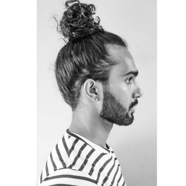 Curly Top Bun Hairstyle For Men