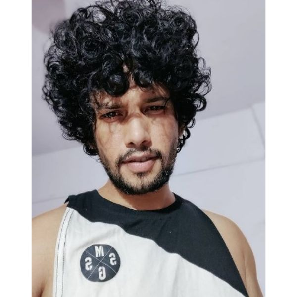 Dark Curly Hairstyle For Men
