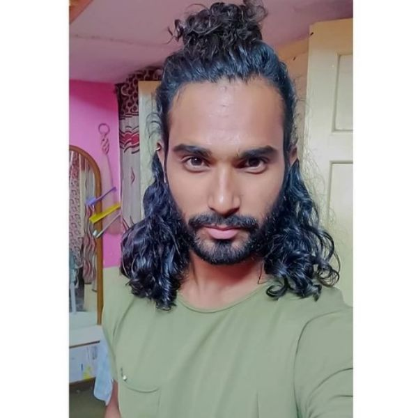 Half Man Bun Curly Hairstyle For Men