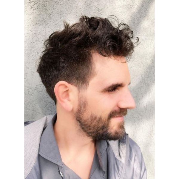 High Fade with Curly Messy Top Hairstyle For Men