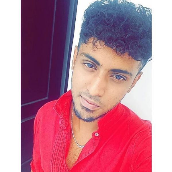 High Fade with Curly Top Hairstyle For Men
