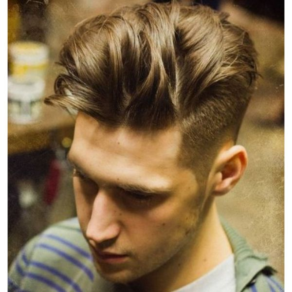 High Fade with Spiky Layered Top Haircut layered haircuts for men