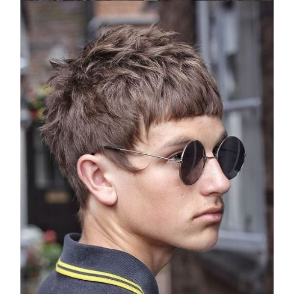 Rock'n Roll Style Cropped Haircut with Long Sideburns layered haircuts for men