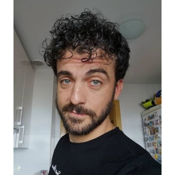Short Curly Hairstyle With Mustache and Beard