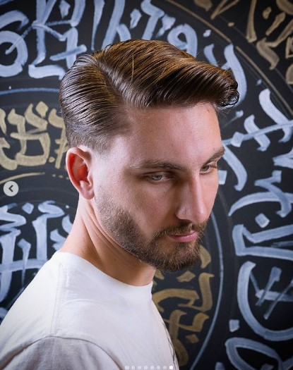 Sleek Side-swept Taper Haircut with Deep Side Part
