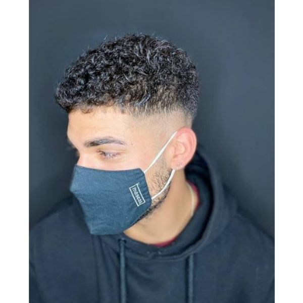 Tight Fade With Curly Perm Hairstyles For Men curly hairstyles for men